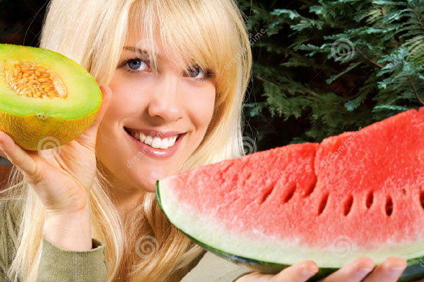 http://www.dreamstime.com/royalty-free-stock-photo-woman-holding-melons-image2701905